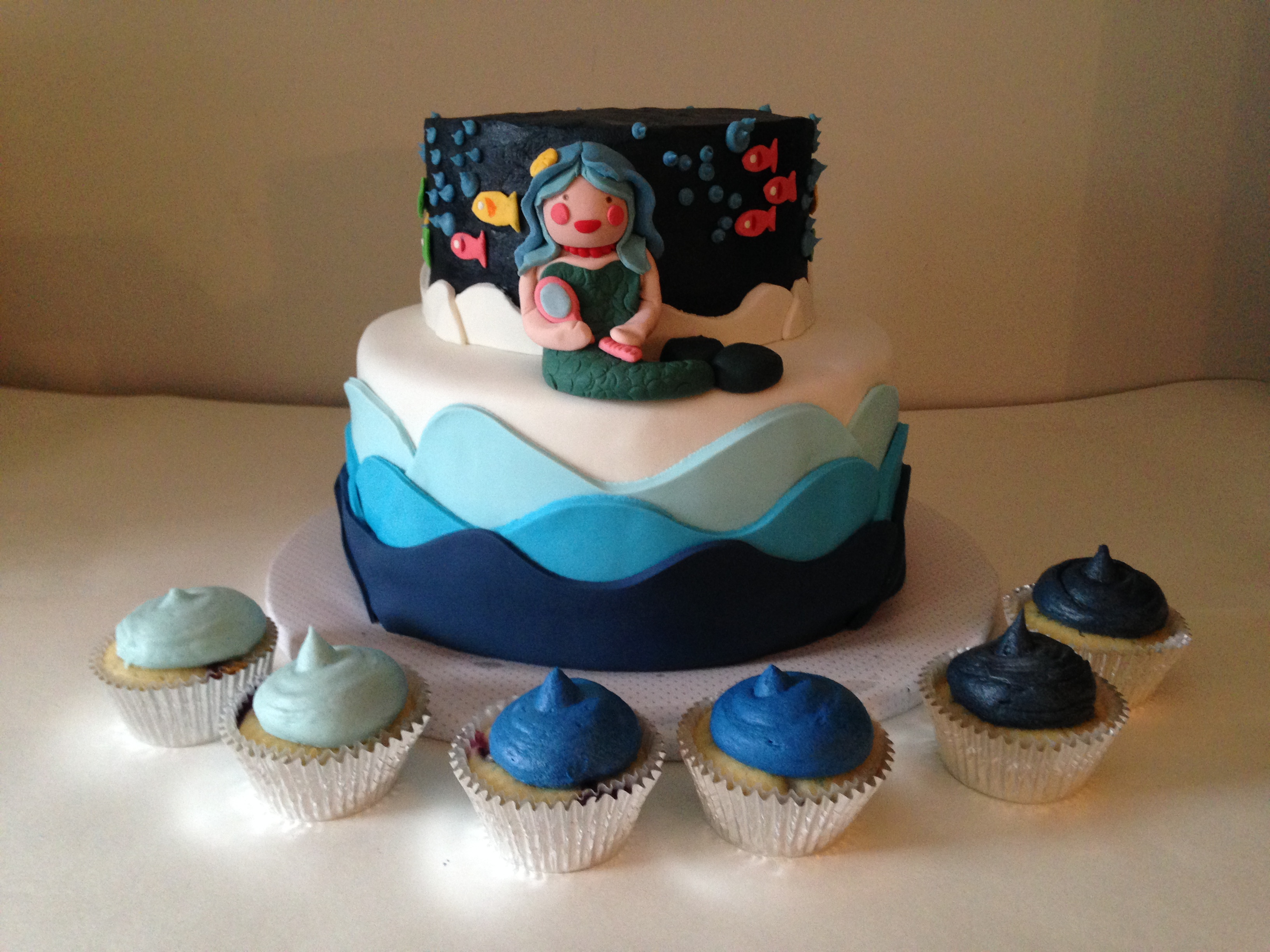 under the sea mermaid cake and ombre blue cupcakes
