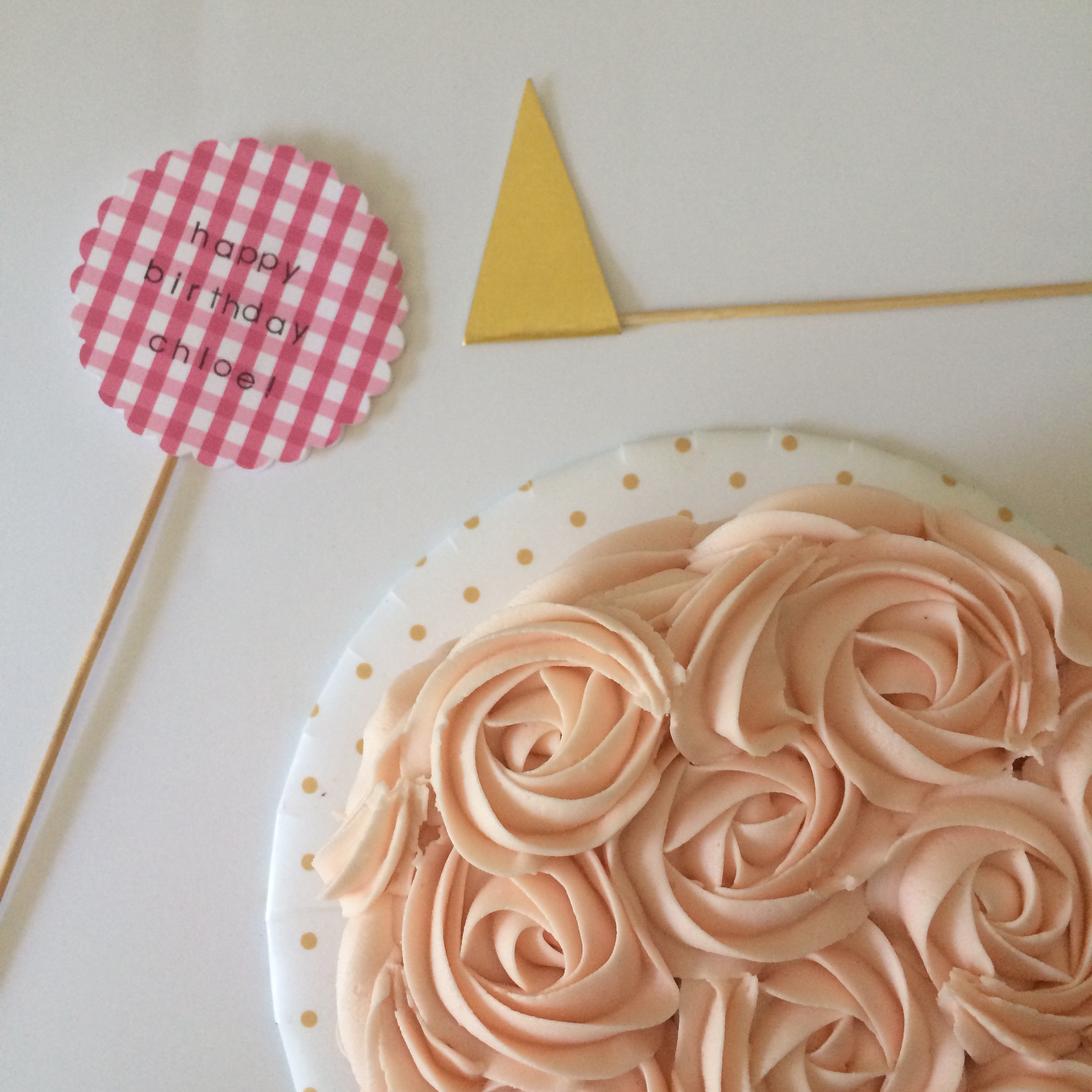 rose cake with paper flags